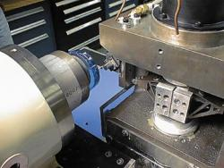 Photograph of rotary fast-tool diamond turning machine.